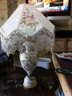 Old table lamp with a hand made victorian shade