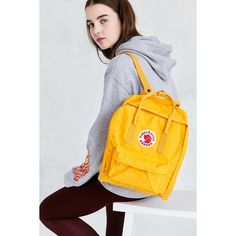 Fjallraven Kanken Backpack ($75) ❤ liked on Polyvore featuring bags, backpacks, fjallraven bag, yellow bag, knapsack bag, day pack backpack and fjallraven rucksack
