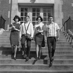 Four students on steps outside university Canvas Art - (18 x 24)
