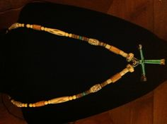 Bone necklace with cross.