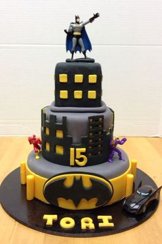Batman birthday cake. Southern living recipe for white cake with vanilla buttercream covered with fondant.