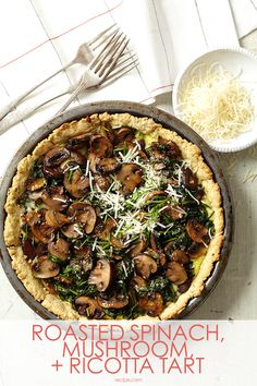 A savory pie filling (ricotta, Parmesan and eggs) is hiding under the thick layer of mushrooms and spinach in this brunch tart.