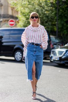 Let heels and a sophisticated blouse take your denim skirt up a notch.