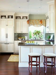 I love this cozy kitchen! Build additions to cabinets to ceiling!!!