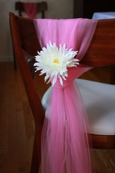 Pink tulle chair covers with flower