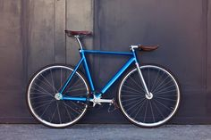electron blue fixed gear bike with brown leather
