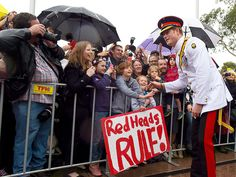Prince Harry Poses with Young Fan's 'Red Heads Rule' Sign During Australian Tour http://www.people.com/people/package/article/0,,20395222_20913119,00.html