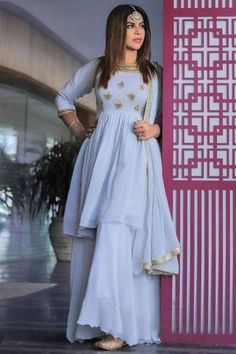Specifically designed for a stylish lady like you is this ice blue georgette sharara suit which will surely make a standout addition at every party you go. This round neck and 3/4th sleeve wedding wear dress elaborated using sequins and zari work. Teamed up with georgette sharara pants in ice blue color with ice blue georgette dupatta. Sharara pants has plain. Dupatta embellished in lace work. #shararasuits #malaysia #Indianwear #weddingwear #andaazfashion Sharara Suit, Churidar Suits, Ice Blue Color, Pantalon Cigarette, Funky Dresses, Bollywood Dress, Yellow Kurti, Ethnic Looks, Ethnic Outfits