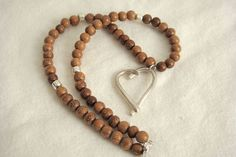 Silver Heart & Wood Bead Necklace by lizrubi on Etsy, $29.00