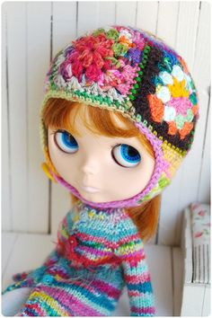 granny square hat, & the sweater is adorable!!!!!  Not for doll though, for little girls &  us older ones too!!!!!!!!!!