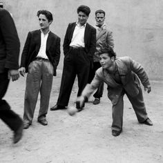 Men Playing Bocce in San Giovanni in Fiore Photographic Print at Art.com