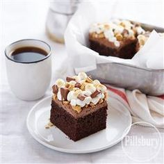 Bring the taste of the campfire inside with this S'mores-Topped Chocolate Cake from Pillsbury® Baking!