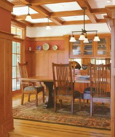 Cabinetry built into the woodwork was a common feature of Arts & Crafts dining rooms.