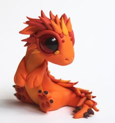 This little guy was a custom order. The first in a series of 4. He's fire and his name is Aiden and the next one will be a little girl dragon. she will be air and I will have to f...