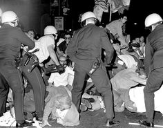 Helmeted Chicago cops flail into crowd of antiwar rioters outside the Democratic National Convention in 1968
