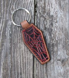 hand tooled and stamped leather keychain hotrod, pinstripe spiderweb coffin design.