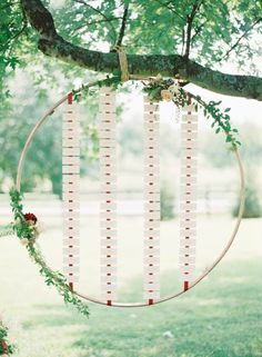 Repurpose an embroidery hoop for a super creative + super easy wedding seating chart.