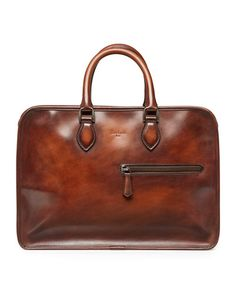 Berluti hand-polished leather briefcase. Rolled top handles with rings. Zip-top closure. Front exterior zip pocket. Made in Italy.
