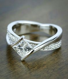 A beautiful Bezel Bridge Princess Cut Diamond Engagement Ring in White Gold