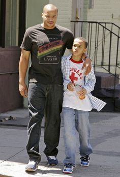 Donald Faison and 1 of 4 children.