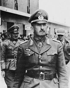 Gen. Hans-Jürgen von Arnim, commander of the Axis forces in North Africa, on May 15, 1943, three days after his capture and shortly before being flown to a prison in England. Behind him is General Hans Cramer, commander of the German Afrika Korps.