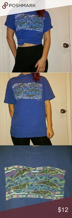 Vintage dolphin tee Vintage Australia tourist tee. Tag has faded away, but I'm a size small for reference.   ??BOGO 50% OFF?? My whole closet is buy one get one 50% off, now through the end of March. Please add the items you want to a bundle and make the correct offer, and I'll accept. 1st item is full price, 2nd item of equal or lesser value will be half off. UNIF Tops Tees - Short Sleeve