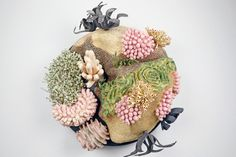 """A small sculpture by Mattison standards — """"basically the size of a large pizza"""" — Coral Triangle depicts one of the ocean's """"hope spots."""" Th..."""