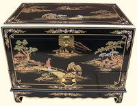 Shiny black lacquer trunk with hand painted designs.