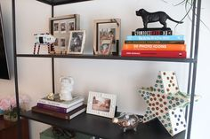 Ross's Greenwich Village Home living room entryway hallway bookcase books vignette art