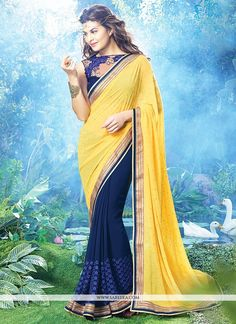 Jacqueline fernandez yellow and blue georgette saree add the sense of elegant and glamorous. This attire is beautifully adorned with resham, lace and stones work adornsthe drape look. Comes with match...