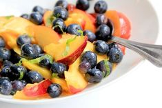 Bright shiso leaves and a touch of earthy sesame oil enhance this stone fruit and berry salad.