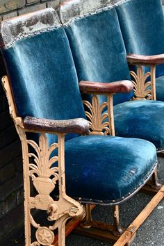 Blue velvet theatre seats- Maybe they kept a row from their latest Cinema remodel and have it a piece of furniture at their home?