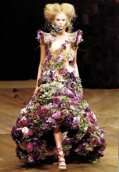 The Sarabande Flower Dress worn by Tanya Dziahileva in McQueen's 2007 Spring RTW Collection. The flowers on the gowns were real. When the flowers began to fall off onto the catwalk, the audience assumed it was deliberate. But they fell off because they were put on only minutes before the show.