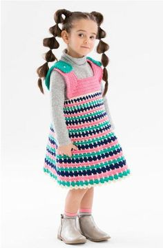 This comfortable crochet jumper has bright colored stripes and is easy to accessorize according to the season. This crochet toddler dress is written for sizes two through size years, so it's perfect for any little toddler.