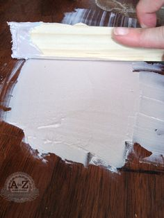 repairing damaged veneer, painted furniture, woodworking projects, Spreading the Bondo