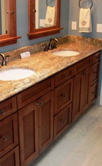 custom, solid wood, double sink bathroom vanity, designed and built by Borders Woodworks for a new custom home built by Whyrick Builders, both of Jacksonville, Florida.