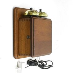 A really nice telephone extension bell supplied with long extension lead and double socket, unplug your phone from the wall, plug in the double plug then plug the bell and phone in and hey presto! a tested and working telephone extension bell. Solid mahogany box, polished, solid brass bells.