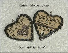 soldered Valentine hearts with vintage German sheet music paper and silver glitter