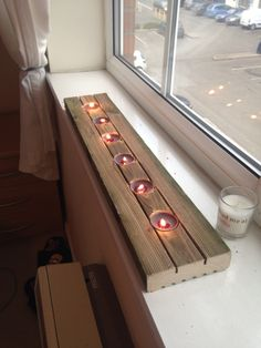 Candles in an old piece of decking