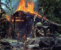 A Viet Cong base camp being burned My Tho South Vietnam 1968
