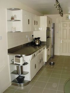 English Rose kitchen, 1950 retro and Stainless steel worksurfaces