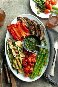 The bright spicy flavor of basil chimichurri sauce adds a little zip to summery grilled vegetables.