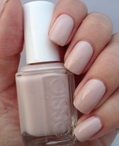 "Most popular nail polish on Pinterest is the perfect nude —Essie, ""Topless & Barefoot"". It's flattering on all skin tone sand has a hint of pink!"