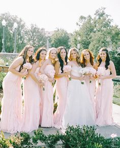 Pretty Pink Bridesmaid Dresses |: Mariel Hannah Photography | blog.theknot.com