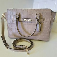 ⤵⤵VERY RARE COLORCOACH Embossed BLAKE The most iconic piece of Coach hardware has been reimagined as an elongated, double-turnlock statement piece, updating one of our most popular designs with a little bit of swagger Named for a bold, brass-trimmed Bonnie Cashin design from 1967, this spacious, modern carryall is finished by hand in tactile croc-embossed leather with a detachable strap for shoulder or crossbody wear. Absolutely stunning!!   VERY RARE COLOR  Coach Bags Shoulder Bags