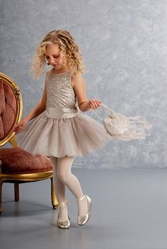 Biscotti Holiday Luminous Lace Gold Drop Waist Tulle Dress  Your Little girl will love twirling in this beauty. The Biscotti Holiday Luminous Lace Gold Drop Waist Tulle Dress is glamorous in its gold tulle and lace dress. This pretty outfit would be perfect for holiday pageants and performances.