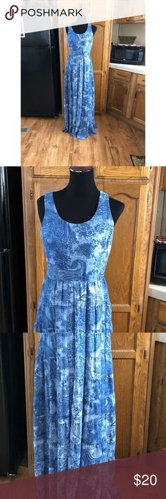 Betsy Johnson Blue Maxi Dress Size 6 Maxi dress by Betsy Johnson.  Blue pattern. Top layer is sheer gas underneath liner that is shorter.  T-back.  Skirt has minimalist there ruffles.  Size 6.  Good condition.  Important:   All items are freshly laundered as applicable prior to shipping (new items and shoes excluded).  Not all my items are from pet/smoke free homes.  Price is reduced to reflect this!   Thank you for looking! Betsey Johnson Dresses Maxi