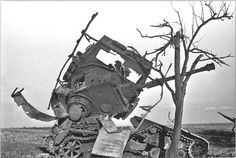 What appears to be Panzer IV, throughly destroyed. I can only think of two explanations for the extreme damage: 1, a Soviet SU-152 self-propelled artillery piece often used in anti-tank roles worked its magic, or the tank was irreparably damaged and blown up by Germans.
