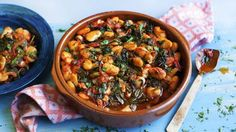 This recipe comes from Epirus in northern Greece, where they grow plenty of giant butter beans which they cook with tomatoes and wild greens. To make it easy, I have used chard, in case you don't fancy going out to gather dandelions or sea kale.