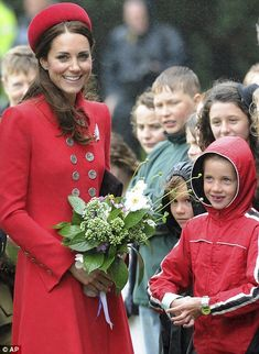 Young school children presented the Duchess with a bouquet of flowers 7 Apr 2014